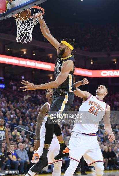 JaVale McGee of the Golden State Warriors goes up for a slam dunk against the Phoenix Suns during an NBA basketball game at ORACLE Arena on February...