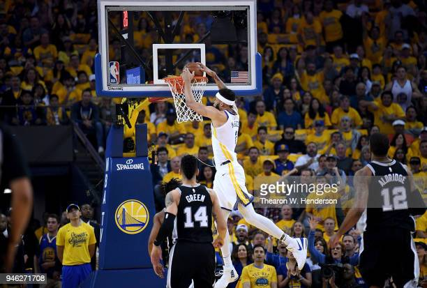 JaVale McGee of the Golden State Warriors goes up for a slam dunk against the San Antonio Spurs in the first quarter during Game One of the first...
