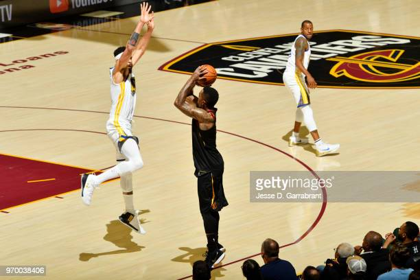 JaVale McGee of the Golden State Warriors goes up to the block on JR Smith of the Cleveland Cavaliers in Game Four of the 2018 NBA Finals on June 8...