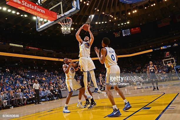 JaVale McGee of the Golden State Warriors grabs a rebound against the Indiana Pacers on December 5 2016 at ORACLE Arena in Oakland California NOTE TO...