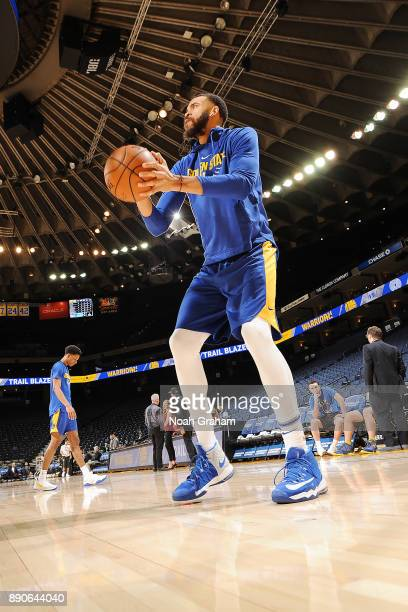 JaVale McGee of the Golden State Warriors handles the ball against the Portland Trail Blazers on December 11 2017 at ORACLE Arena in Oakland...