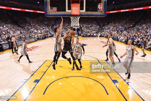 JaVale McGee of the Golden State Warriors handles the ball against the San Antonio Spurs on February 10 2018 at Oracle Arena in Oakland California...