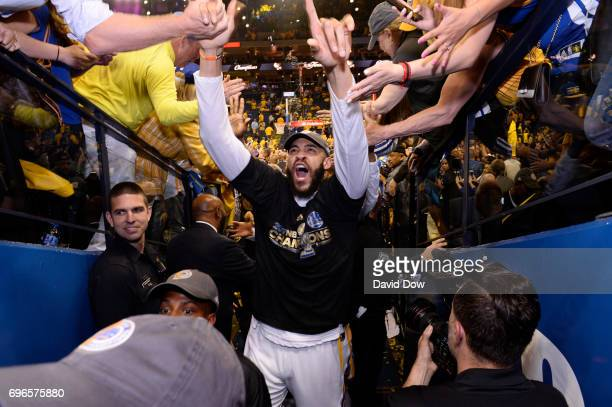 JaVale McGee of the Golden State Warriors high fives fans as he walks off the court after winning Game Five of the 2017 NBA Finals against the...