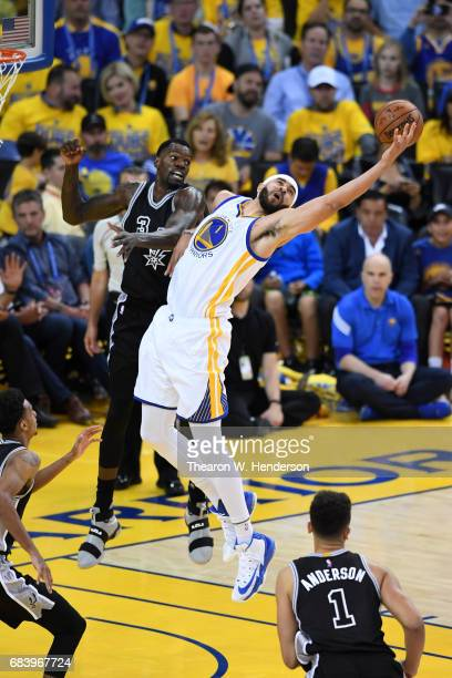 JaVale McGee of the Golden State Warriors jumps for a rebopund against Dewayne Dedmon of the San Antonio Spurs during Game Two of the NBA Western...