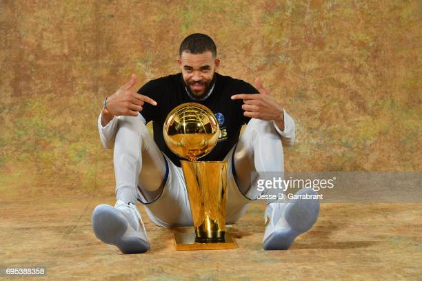JaVale McGee of the Golden State Warriors poses for a portrait with the Larry O'Brien Trophy after defeating the Cleveland Cavaliers in Game Five of...