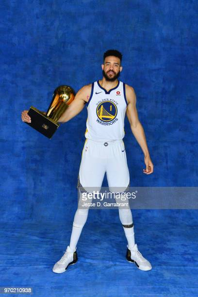 JaVale McGee of the Golden State Warriors poses for a portrait with the Larry O'Brien Championship trophy after defeating the Cleveland Cavaliers in...