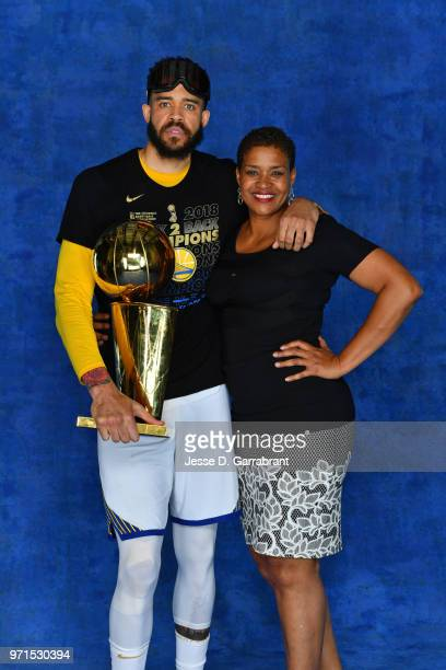 JaVale McGee of the Golden State Warriors poses for a portrait with his mother and Former WNBA player Pamela McGee and the Larry O'Brien Trophy after...