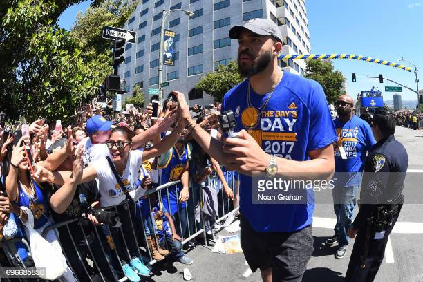 JaVale McGee of the Golden State Warriors shakes fans hands during the Victory Parade and Rally on June 15 2017 in Oakland California at The Henry J...