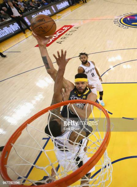 JaVale McGee of the Golden State Warriors shoots over LaMarcus Aldridge of the San Antonio Spurs during Game 2 of Round 1 of the 2018 NBA Playoffs at...