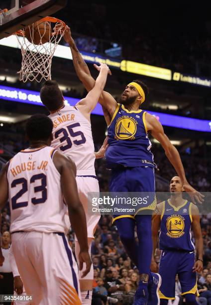 JaVale McGee of the Golden State Warriors slam dunks the ball over Dragan Bender of the Phoenix Suns during the first half of the NBA game at Talking...