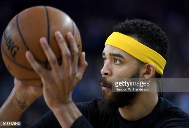 JaVale McGee of the Golden State Warriors wearing an NBA head band warms up prior to the start of an NBA basketball game against the Phoenix Suns at...