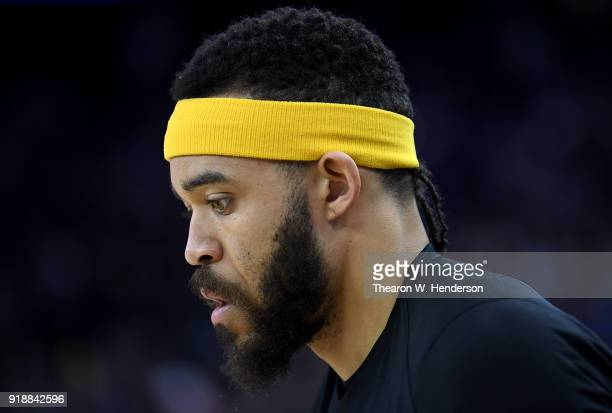 JaVale McGee of the Golden State Warriors wearing an NBA head band looks on during warm ups prior to the start of an NBA basketball game against the...