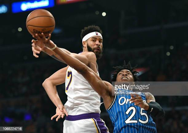 JaVale McGee of the Los Angeles Lakers blocks a layup by Wesley Iwundu of the Orlando Magic during the first half at Staples Center on November 25...