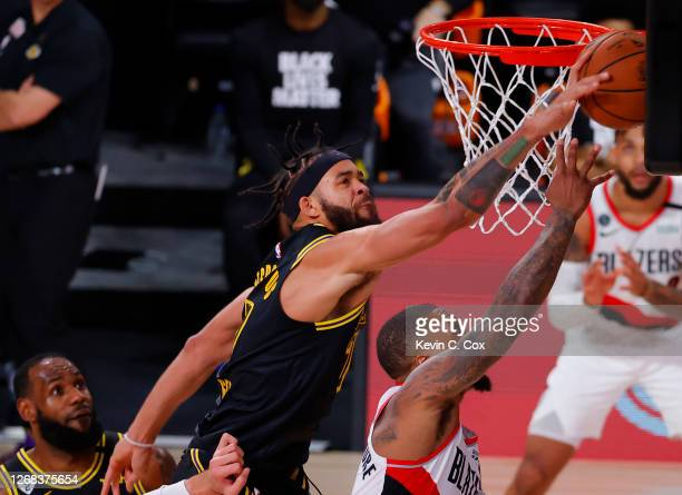 JaVale McGee of the Los Angeles Lakers blocks a shot by Damian Lillard of the Portland Trail Blazers during the third quarter in Game Four of the...