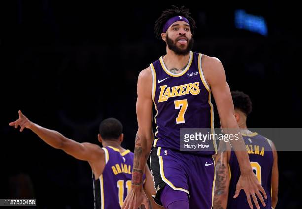 JaVale McGee of the Los Angeles Lakers celebrates his pass leading to a LeBron James dunk during the first half against the Golden State Warriors at...