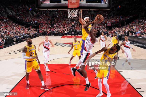 JaVale McGee of the Los Angeles Lakers contests the shot by AlFarouq Aminu of the Portland Trail Blazers on October 18 2018 at the Moda Center in...