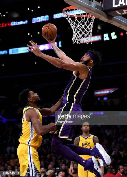 JaVale McGee of the Los Angeles Lakers dunks in front of Glenn Robinson III and D'Angelo Russell of the Golden State Warriors during a 12094 Lakers...