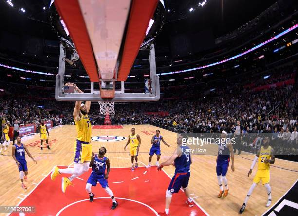 JaVale McGee of the Los Angeles Lakers prepares to dunk in front of Patrick Beverley and Boban Marjanovic of the LA Clippers during a 123-120 Laker...