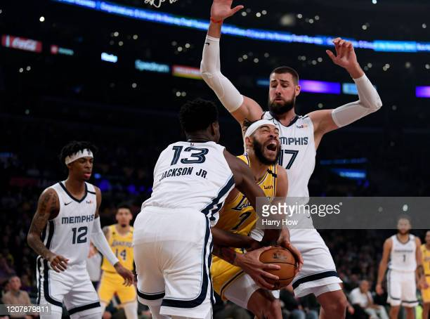 JaVale McGee of the Los Angeles Lakers reacts as he is fouled by Jaren Jackson Jr #13 of the Memphis Grizzlies in front of Jonas Valanciunas during...