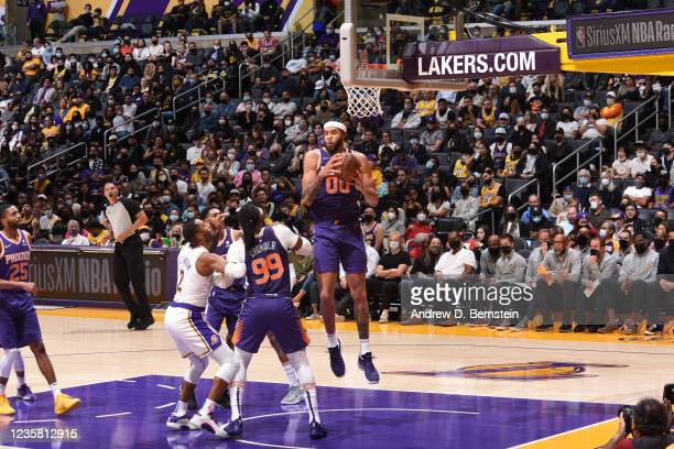 JaVale McGee of the Phoenix Suns catches the rebound during a preseason game against the Los Angeles Lakers on October 10, 2021 at STAPLES Center in...