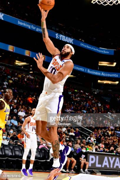JaVale McGee of the Phoenix Suns drives to the basket against the Los Angeles Lakers during a preseason game on October 6, 2021 at Footprint Center...