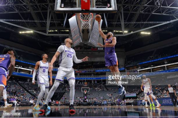 JaVale McGee of the Phoenix Suns drives to the basket against the Sacramento Kings during a pre-season game on October 4, 2021 at Golden 1 Center in...