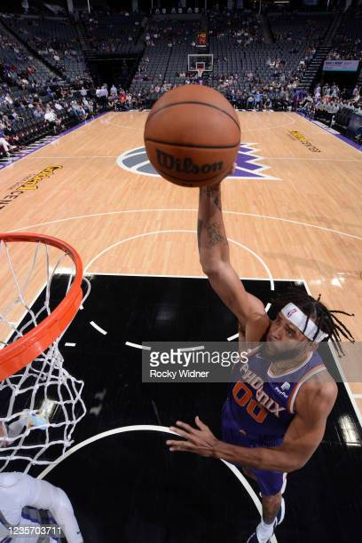 JaVale McGee of the Phoenix Suns drives to the basket during the game against the Sacramento Kings during a pre-season game on October 4, 2021 at...