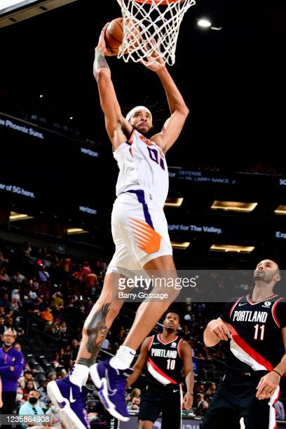 JaVale McGee of the Phoenix Suns dunks the ball during a preseason game against the Portland Trail Blazers on October 13, 2021 at Footprint Center in...