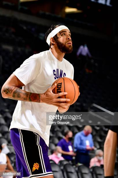 JaVale McGee of the Phoenix Suns handles the ball before the game against the Los Angeles Lakers during a preseason game on October 6, 2021 at...
