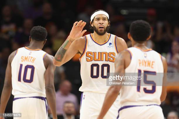 JaVale McGee of the Phoenix Suns high fives Cameron Payne during the NBA preseason game at Footprint Center on October 06, 2021 in Phoenix, Arizona....
