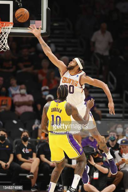 JaVale McGee of the Phoenix Suns lays up a shot over DeAndre Jordan of the Los Angeles Lakers during the NBA preseason game at Footprint Center on...