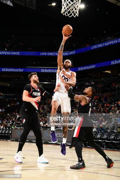 JaVale McGee of the Phoenix Suns shoots the ball during a preseason game against the Portland Trail Blazers on October 13, 2021 at Footprint Center...