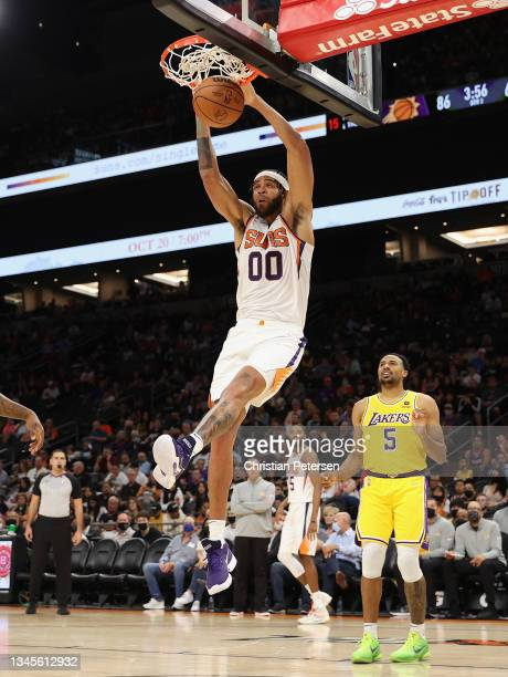 JaVale McGee of the Phoenix Suns slam dunks against the Los Angeles Lakers during the NBA preseason game at Footprint Center on October 06, 2021 in...