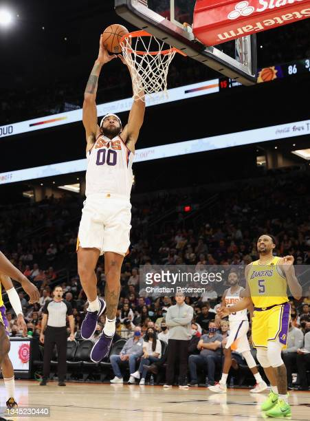 JaVale McGee of the Phoenix Suns slam dunks the ball over Talen Horton-Tucker of the Los Angeles Lakers during the second half of the NBA preseason...