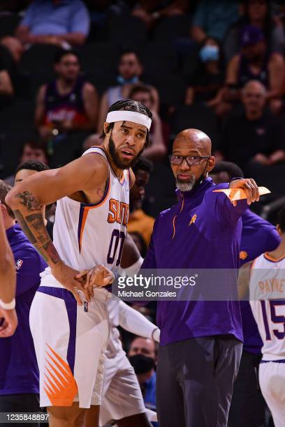 JaVale McGee of the Phoenix Suns talks with Head Coach Monty Williams of the Phoenix Suns during a preseason game against the Los Angeles Lakers on...