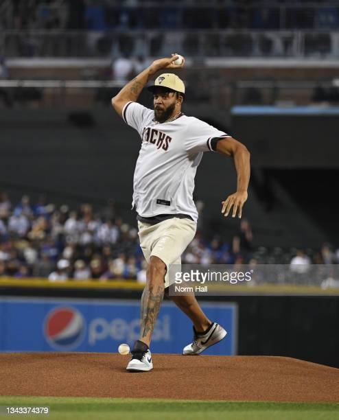 JaVale McGee of the Phoenix Suns throws out a ceremonial first pitch prior to a game between the Arizona Diamondbacks and Los Angeles Dodgers at...