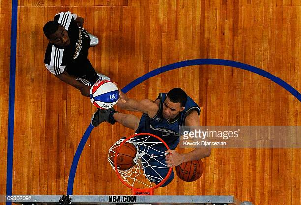 JaVale McGee of the Washington Wizards dunks three balls on the same jump after a pass from teammate John Wall in the second round of the Sprite Slam...