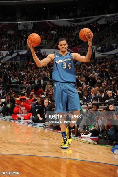 JaVale McGee of the Washington Wizards holds up two basketballs during the Sprite Slam Dunk Contest at Staples Center on February 19 2011 in Los...