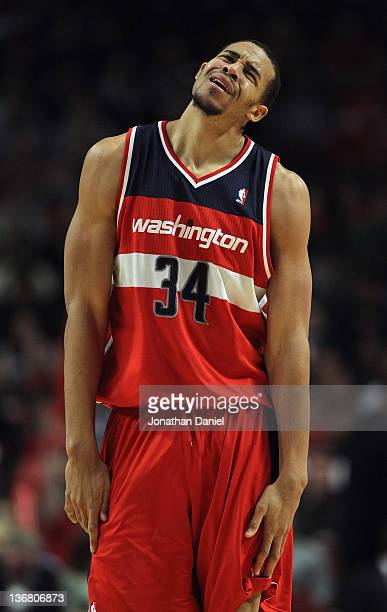 JaVale McGee of the Washington Wizards reacts after being called for a foul against the Chicago Bulls at the United Center on January 11 2012 in...