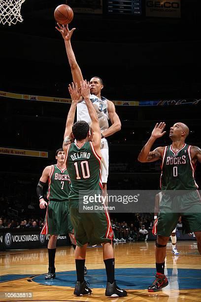 JaVale McGee of the Washington Wizards shoots over Carlos Delfino of the Milwaukee Bucks at the Verizon Center on October 14 2010 in Washington DC...