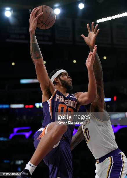 JaVale McGee Phoenix Suns shoots over DeAndre Jordan of the Los Angeles Lakers during the second half of a preseason game at Staples Center on...