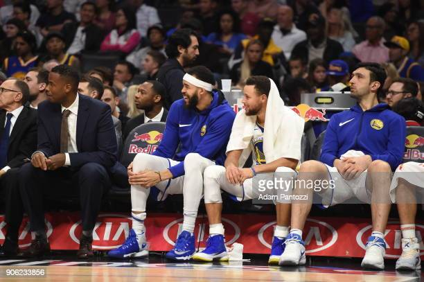 JaVale McGee Stephen Curry and Zaza Pachulia of the Golden State Warriors looks on during the game against the LA Clippers on January 6 2018 at...