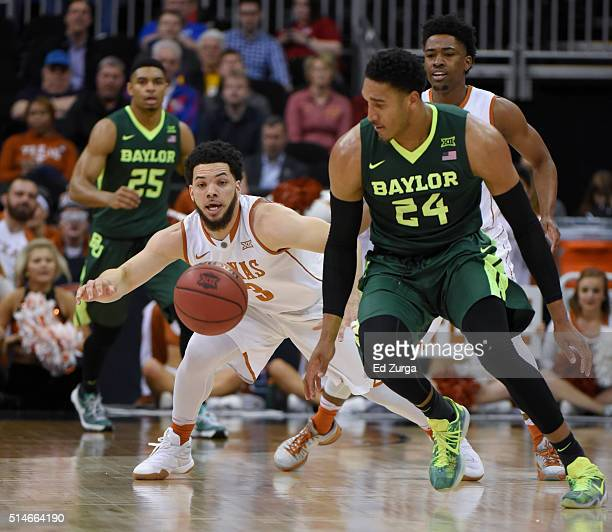 Javan Felix of the Texas Longhorns and Ishmail Wainright of the Baylor Bears chase down a loose ball in the first half during the quarterfinals of...
