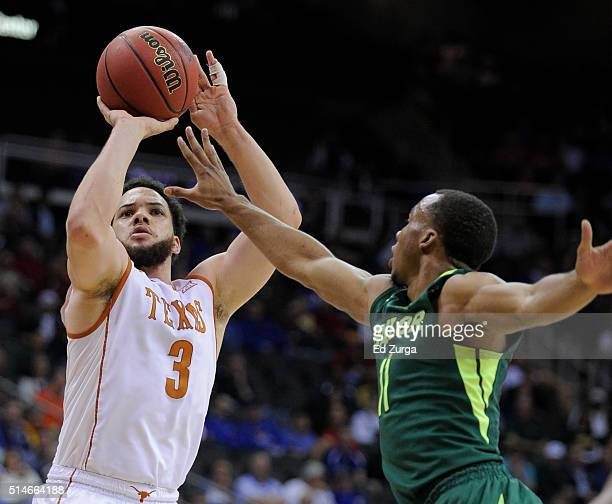 Javan Felix of the Texas Longhorns shoots against Lester Medford of the Baylor Bears in the first half during the quarterfinals of the Big 12...
