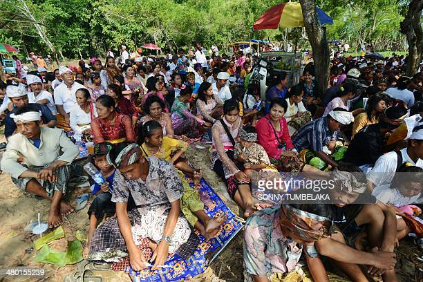 Javanese Hindus attend a Melasti ceremony prayers on Pulau Merah in Banyuwangi regency in East Java province on March 23 west of Indonesia's resort...