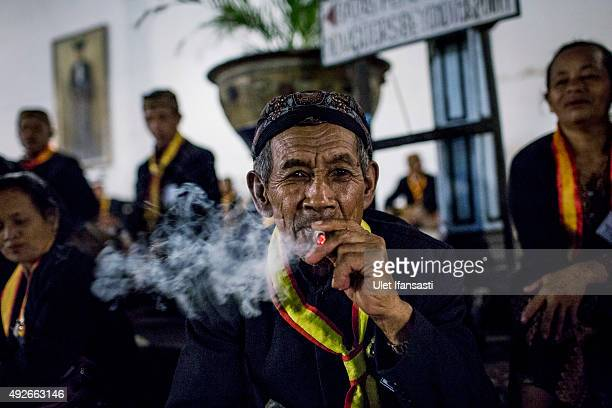 Javanese man smokes in the yard of Kasunanan Surakarta as awaiting the traditional night carnival '1st Suro' marking the 1437th Islamic New Year...