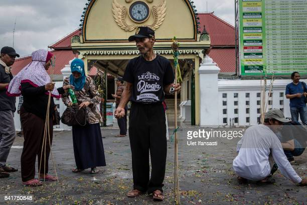 Javanese people collect vegetables from the 'Gunungan' a sacrifice in the shape of a mountain during the Grebeg ritual as part of celebrations for...