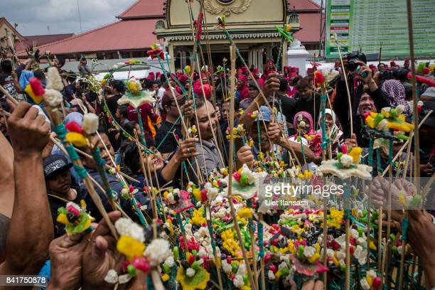 Javanese people jostle for the 'Gunungan' a sacrifice in the shape of a mountain during the Grebeg ritual as part of celebrations for Eid alAdha at...