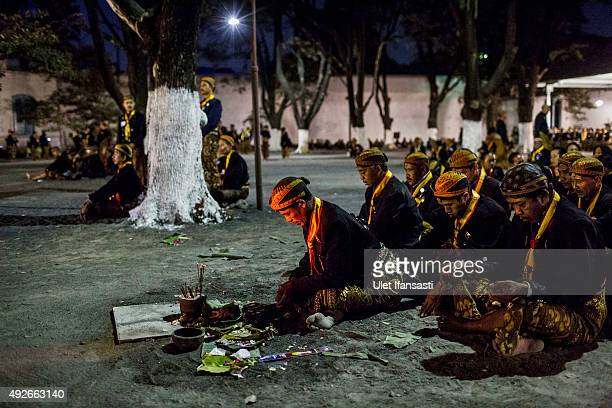 Javanese people pray in yard of Kasunanan Surakarta before the traditional night carnival '1st Suro' marking the 1437th Islamic New Year celebrations...