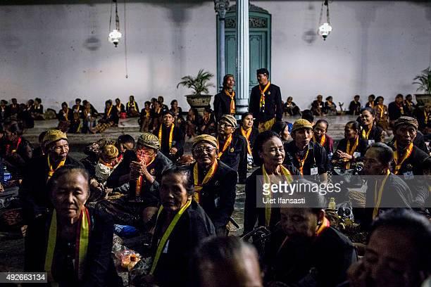 Javanese people sit in yard of Kasunanan Surakarta awaiting the traditional night carnival '1st Suro' marking the 1437th Islamic New Year...